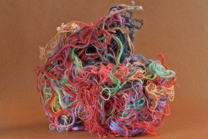 A tangle of differently colored threads