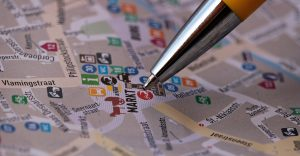 Why directory listings and citations are key for your local business: a pen marking a spot on a map