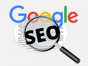Google and SEO words and the magnifying glass.