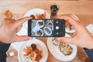 a person taking a photo of a meal