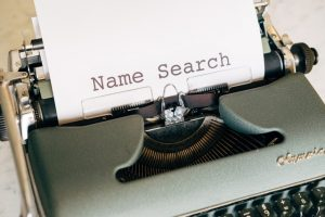 typing machine with the phrase name search printed