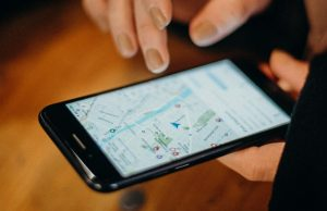 A person is holding a smartphone, and on the screen there is a map. If you are wondering whether or not you can rank with inconsistent NAP, keep in mind that if you provide inconsistent information, that will affect the appearance of your business on applications such as Google Maps.