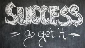 There is a blackboard with and inscription saying SUCCESS- go and get it.
