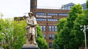 booking building and a statue