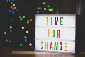 """A led light sign saying """"time for change""""."""