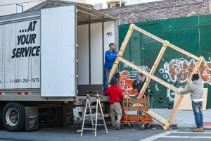 A moving crew loading the truck. If you're wondering how to structure the citation for your business, one of the ways you can do that is to add some additional material such as photos.