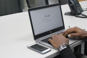 Person using Google on a laptop